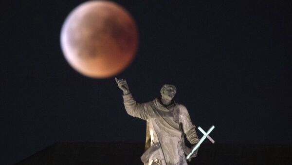 The moon turns red during a total lunar eclipse, as seen from Dresden, Germany, Friday, July 27, 2018. Skywatchers around much of the world are looking forward to a complete lunar eclipse that will be the longest this century. - Sputnik Polska