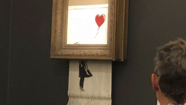 Obraz Banksy'a za 1,4 miliona dolarów, który uległ samozniszczeniu tuż po sprzedaży - Sputnik Polska