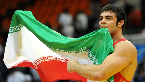 Irański zawodnik Amir Ali Akbari - Sputnik Polska