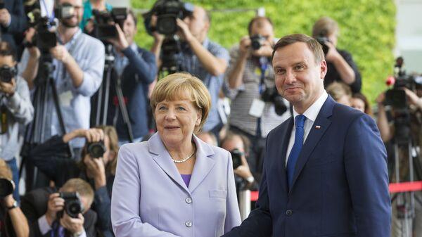 Kanclerz Niemiec Angela Merkel i prezydent Polski Andrzej Duda na spotkaniu w Berlinie, 28 sierpnia 2015 - Sputnik Polska