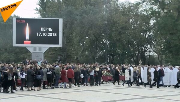 W Kerczu pożegnano ofiary zamachu na uczelni wyższej - Sputnik Polska