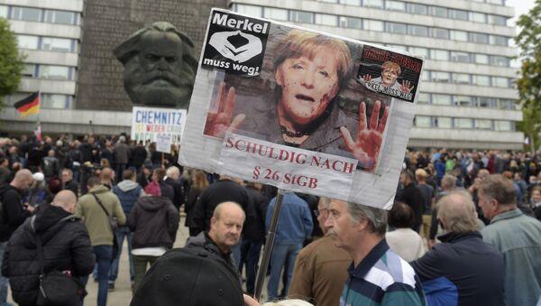 Protesty przeciwko Angeli Merkel - Sputnik Polska