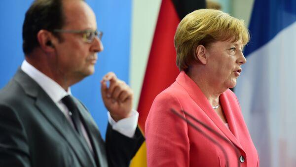 Kanclerz Niemiec Angela Merkel i prezydent Francji Francois Hollande w Berlinie - Sputnik Polska