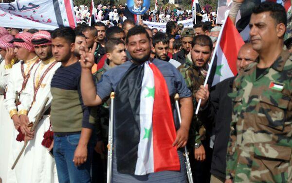 Syryjczycy świętują wyzwolenie od terrorystów - Sputnik Polska