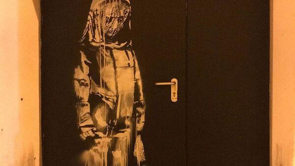 Skradziono dzieło Banksy'ego poświęcone ofiarom zamachu w klubie Bataclan - Sputnik Polska
