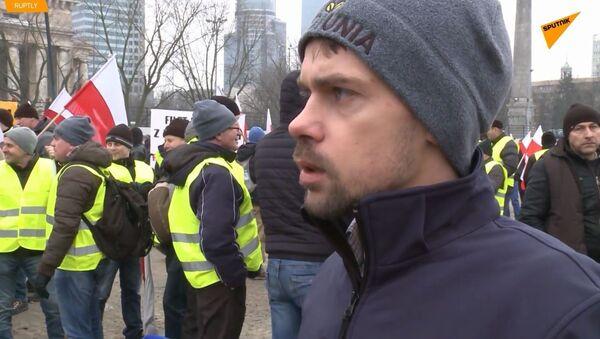Michał Kołodziejczak podczas protestów w Warszawie - Sputnik Polska