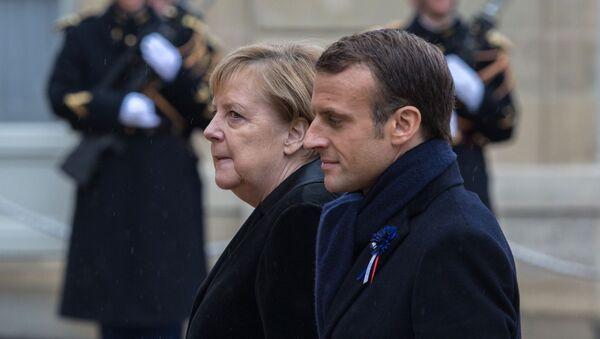 Kanclerz RFN Angela Merkel i prezydent Francji Emmanuel Macron - Sputnik Polska