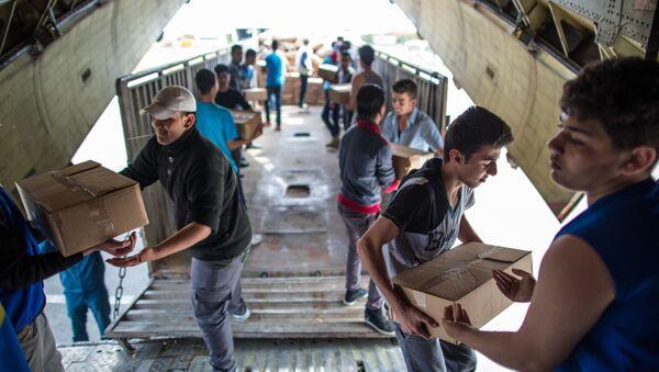 Rosyjski samolot z pomocą humanitarną dla Syrii - Sputnik Polska